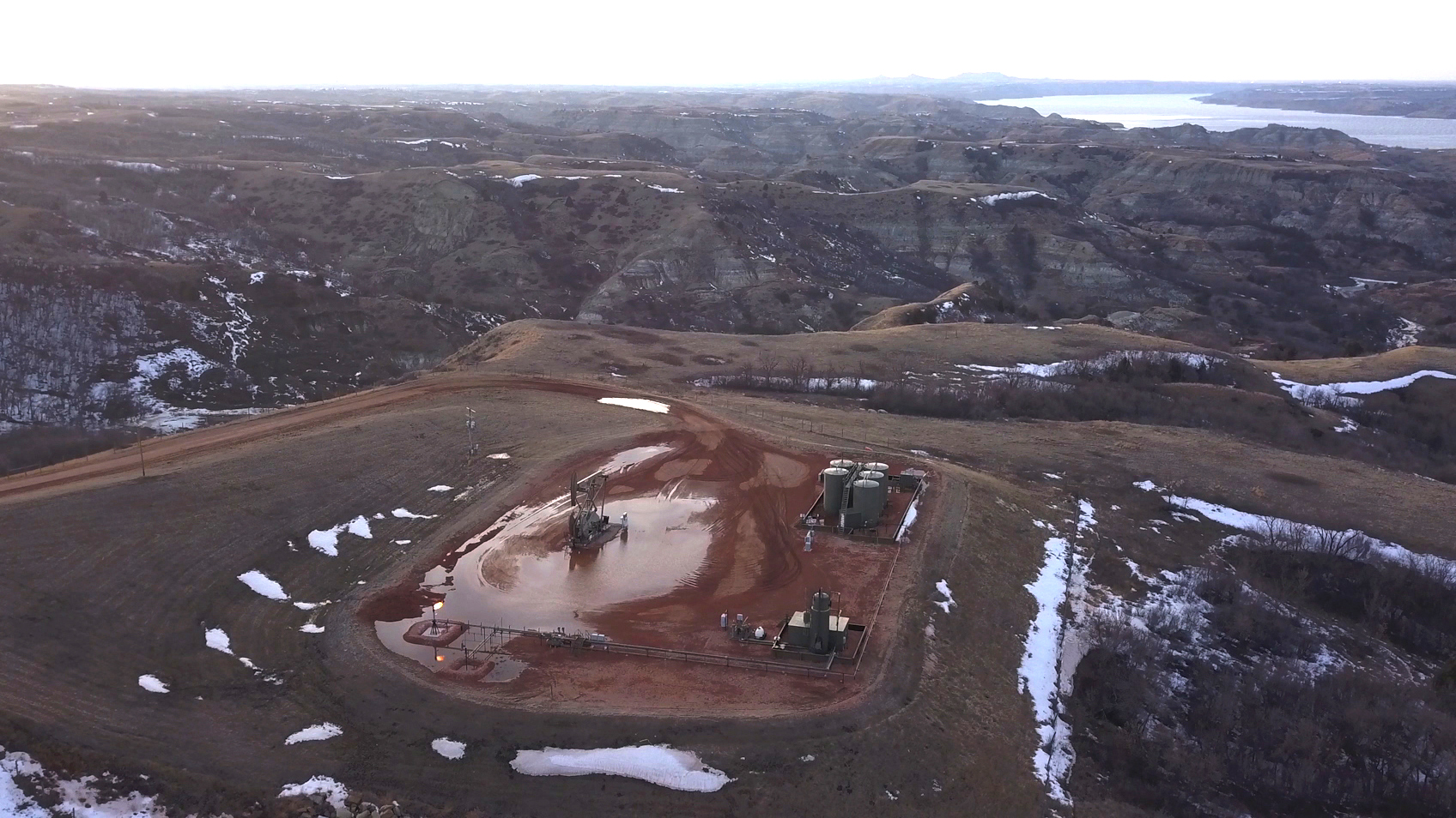 Oil well in the North Dakota Badlands on lands of the MHA Nation, March 2019.  Photo: Angela Anderson